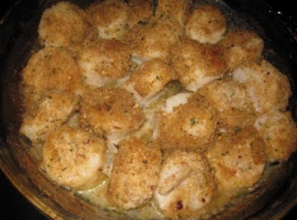 Bake in pre-heated oven until scallops are firm, about 20 minutes.