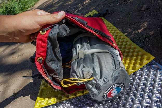 Fly Creek HV UL2 tent in stuff sack being packed into a backpack