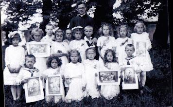 Photo: 01 Grupa dzieci z księdzem M. Kasprukiem 1942 - ostatnia I komunia w Brzozdowcach przed wyjazdem. dzieci z Brzozdowiec, Krasnej Góry i okolic. Monika Zdunek, Romana Kania, Stanisława Ratycz, Jan Gawrecki. 1942 - the last holy communion in Brzozdowce, before leaving, there are children from Brzozdowce and Krasna Góra. Zdjęcie nadesłała Wanda Łyżwa.