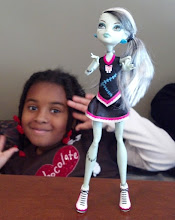 Photo: Kaleya plays w/ her Monster High doll