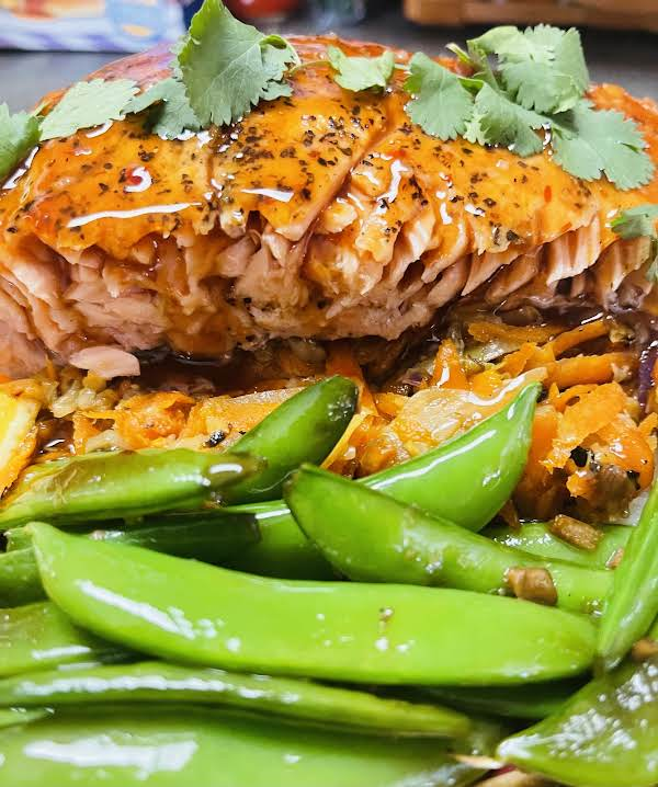 Seared Salmon Over Veggies And Rice And A Side Of Sesame, Garlic Sugar Snap Peas.
