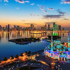 Catch the Sunrise by Wissam Chehade - Buildings & Architecture Other Exteriors ( clouds, cityscapes, skyline, colors, vivid, sky, blue, sunset, uae, warmth, khalid lake, alnoor mosque, alnoor island, sharjah, sharjah light festival,  )