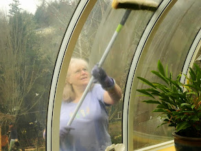 Photo: Anna washing the solarium windows at our service day in August