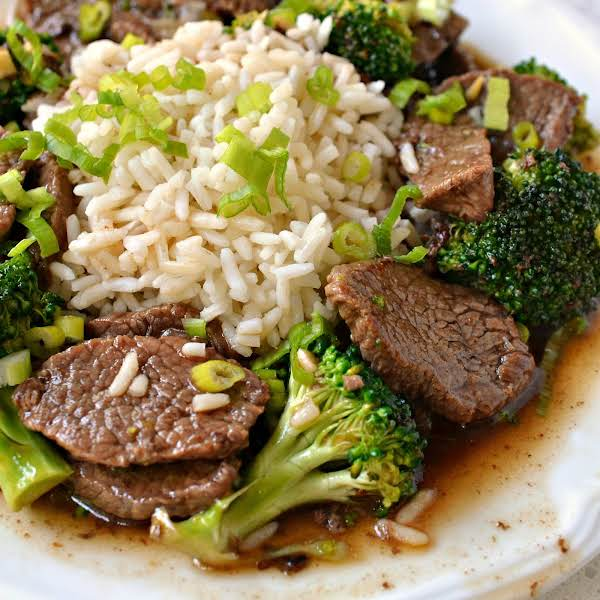 This Family Friendly Easy Beef And Broccoli Is All Made In One Skillet And Is On The Table In Less Than Thirty Minutes.  Crisp Stir Fried Broccoli Is Paired With Tender Cuts Of Beef In A Tasty Salty Sweet Asian Beef Sauce.