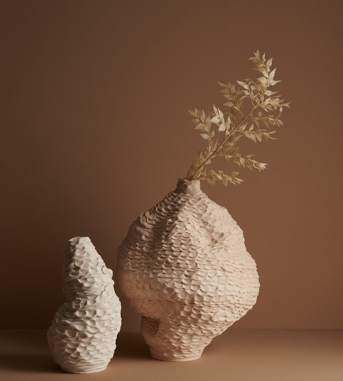 Richly textured ceramic vessels by Ceri Müller.