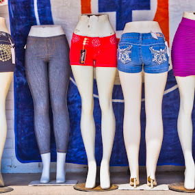 One Size Fits All by Roger Armstrong - City,  Street & Park  Street Scenes ( fashion, street, store front, mannequin, retail )