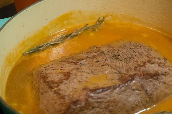 Return the roast to the pot; along with the rosemary, and thyme sprigs.