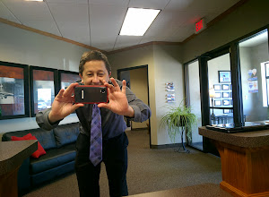 Photo: Stopping by RE/MAX Area Experts - Shannon Gilbert taking a picture of me taking a picture of her #throughglass