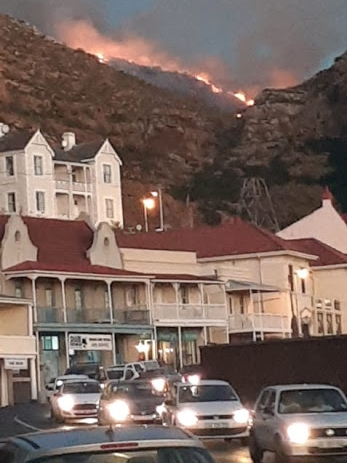 Two helicopters are being used to help contain a fire above Simon's Town.