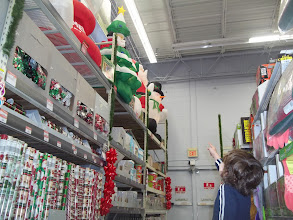 """Photo: Look, it's """"snowman"""" (Santa).  Manasseh is fascinated by the blow-up creatures."""