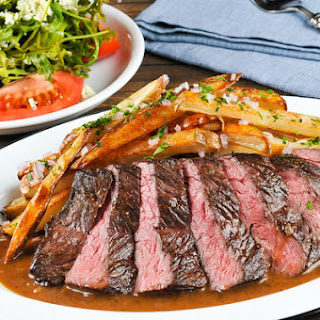 Bistro Steak Frites with shallot pan sauce, bleu cheese, and arugula salad