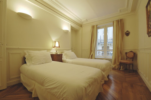 Luxury bedroom at Rue Jean du Bellay Apartments