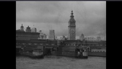 Photo: Shot 2 of 18.  Duration: 2 seconds.  The second of four exterior establishing shots.  A sign in the shot helps underscore the location.  San Francisco's two bridges make visual and verbal appearances--each more than once--lest anyone be left in doubt about the location.