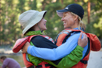 Photo: Mother and daughter hugging while rafting on the Main Salmon River in central Idaho