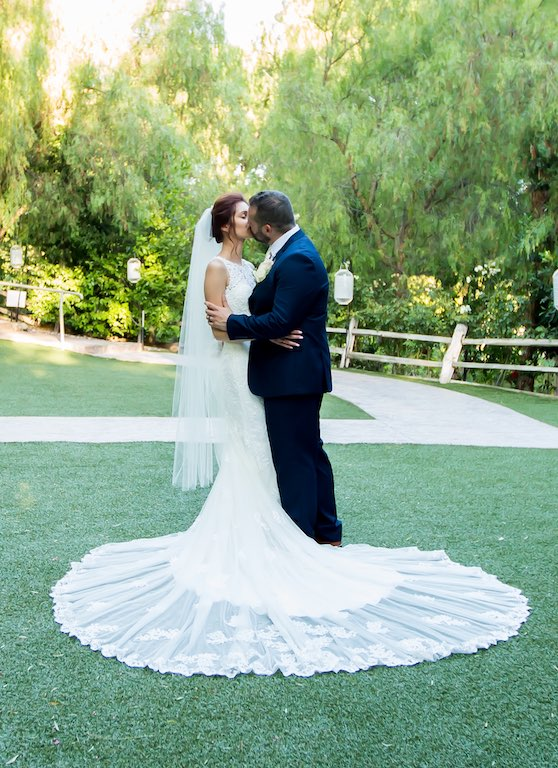 couple at wedding kissing for photo