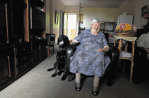 TRUSTED SERVANT: Martie Steyn with her sixth guide dog, Jabula, at her home in Pretoria, yesterday