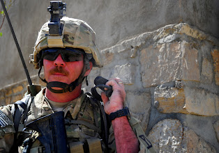 Photo: FARAH, Afghanistan 110926-F-JP934-085 / U.S. Army Sgt. Peter Lescord, from Brookefield, Mass., of 1-182 Infantry Regiment, Charlie Company, security force for Provincial Reconstruction Team Farah, relays information over the radio while on patrol, Purchaman District, Farah Province, Afghanistan, Sept. 26. PRT members escorted members of Farah's Provincial Government to a shura where elders resolve community issues and communicate concerns to the provincial government. PRT Farah attends shuras throughout Farah Province to demonstrate support for the shura elders, the district governor and provincial governance. (ISAF photo/ USAF SrA Alexandra Hoachlander)