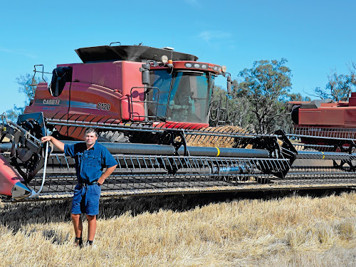Farm manager Jason Denniss of 'Bobbiwaa', Edgeroi, getting ready to climb on the header in preparation for another day of harvesting.