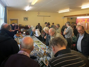 Photo: 013 The 009 Society sales table with scrum surrounding it. Some well known modellers spotted in this photo – can you identify them? .