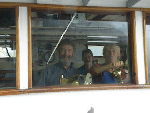 """Photo: Ross and Fern in the wheelhouse, with Karen in the background.  Photo by Niamh (prounounced """"Neeve"""" for those of us in North America)."""