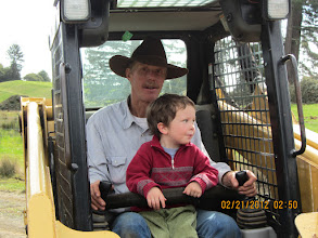 Photo: Quinn and papa playing on the skidsteer