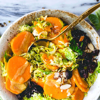 Warm Sweet Potato & Brussels Sprouts Salad with Maple Mustard Dressing.