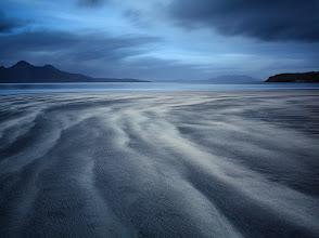 Photo: Isle of Eigg, Scotland  A deserted beach at low tide.
