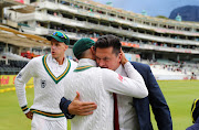 Graeme Smith congratulates Faf du Plessis during Day 4 of the Sunfoil International Test Series cricket match between South Africa and Australia at Newlands in Cape Town on March 25 2018.