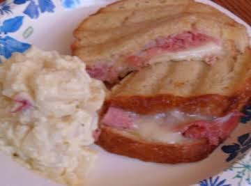 prucuto and swiss stuffed panini