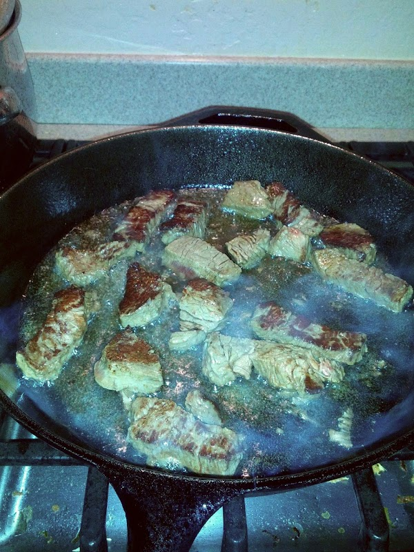 In cast iron pan, add enough oil to cover bottom of pan. Turn on...