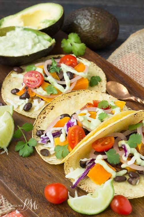 """Black Bean Butternut Squash Tacos with Avocado Cream Sauce """"Full of hearty..."""