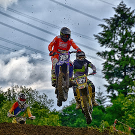 Jumping Duel by Marco Bertamé - Sports & Fitness Motorsports ( clouds, 21, red, motocross, speed, 19, three, number, duel, race, noise )