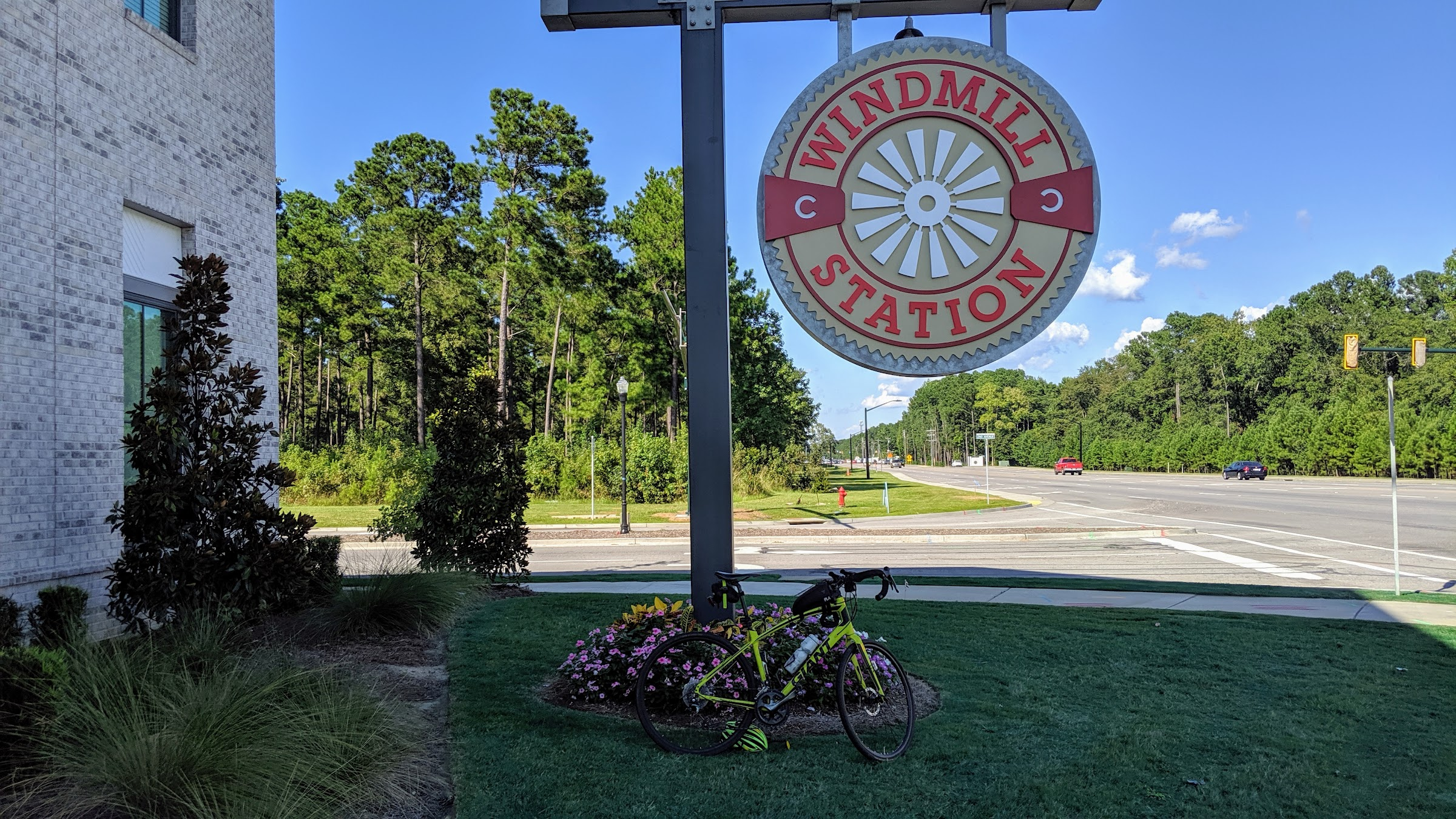 Bicycle in front of Windmill Station sign