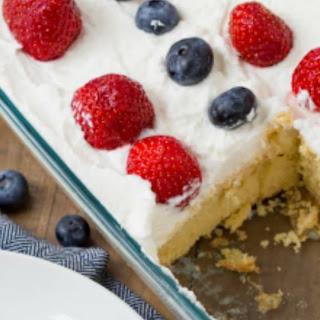 Red White and Blue Cheesecake Poke Cake.