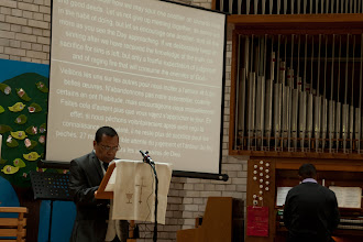 Photo: The Scripture readings were read in Malagasy, with English and French translations on the screen.