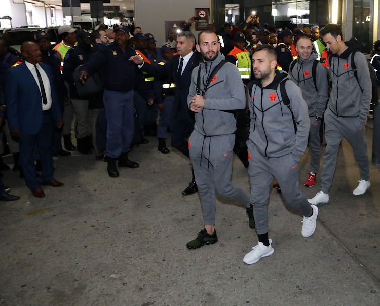 FC Barcelona superstars are ushered out of OR Tambo International Airport amid heavy police presence. The Spanish giants landed on Wednesday May 16 2018 and headed for their hotel in Sandton.