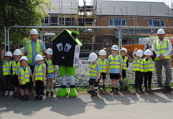 Children visit housing development