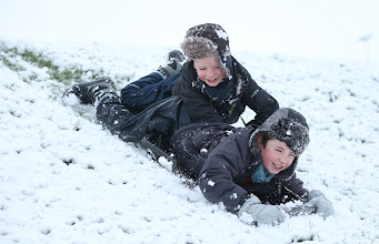 Photo: Daniel and James Egerton play on their sledge in Bingham, Nottinghamshire before school, as the first wave of snow will hit most of the country and some eastern parts of Wales but a second heavier band will fall over central and eastern England later in the day. PRESS ASSOCIATION Photo. Picture date: Monday January 14, 2013. See PA story WEATHER Snow. Photo credit should read: Mike Egerton/PA Wire