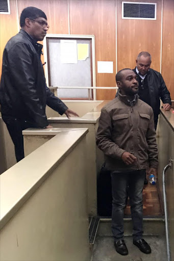 IN THE DOCK: Alleged fraudsters Tholsienathan Pillay, left, Pedro Pinto, back and Julius Okoro appeared in the East London Magistrate Court yesterday accused of stealing close to R2-million Picture: ZWANGA MUKHUTHU
