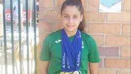 Elena Baca luciendo el oro nacional.