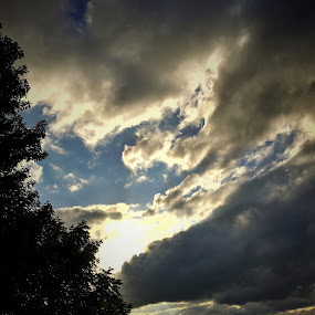 Sun playing peekaboo with storm clouds  by Peggy Clark - Landscapes Cloud Formations ( clouds, sun,  )