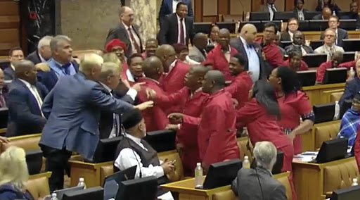 The EFF and DA scuffle at President Cyril Ramaphosa's question and answer session in parliament on Tuesday.