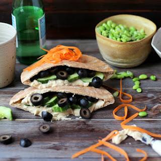 Vegan Pita Sandwich with Hummus, Cucumber and Black Olives.