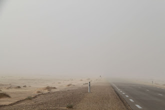 Photo: Through the sandstorm, the wind really picked up and was very difficult to drive.