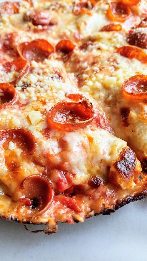 Pizza Jerk cast pepperoni iron pizza