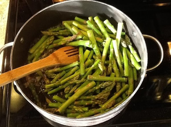 Add asparagus and sauté for about three minutes. Add Italian seasoning and cook for...