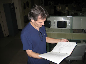 Photo: Vince checks out the Operations manuals and Apollo Launch Commit Criteria binders... which are still in the room!