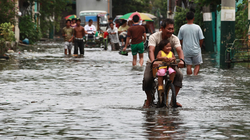 Photo: 20120801 A kid enjoys a bike ride thru flooded streets of Panghulo in Malabon City. Photo by RemZamora