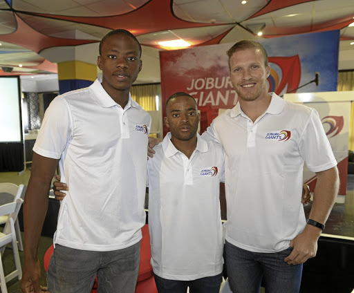 Long and short of it: Kagiso Rabada, left, Temba Bavuma, centre, and André Malan at the launch of the Joburg Giants at the Wanderers on Wednesday. Picture: SYDNEY SESHIBEDI/GALLO IMAGES