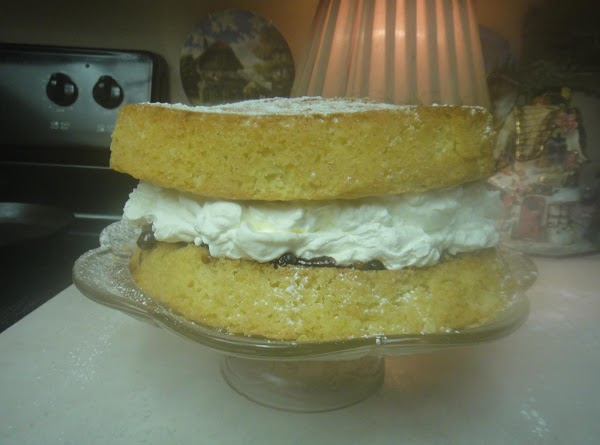 Place the cream on top of the bottom cake with the jam on top....